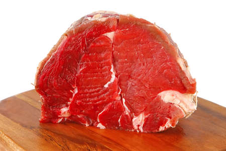 beef meat on cutting plate over white photo