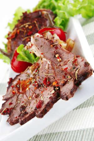 roast beef meat slices on ceramic plate photo