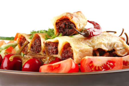 traditional italian cannelloni with tomato and peppers photo