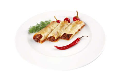 traditional italian cannelloni with red hot peppers photo