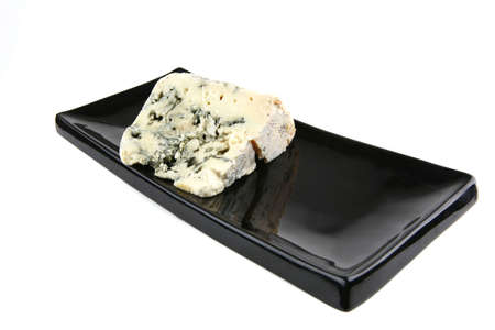 veined: french roquefort soft cheese on black plate Stock Photo