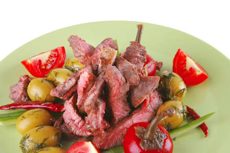 roast beef meat on green dish over white photo
