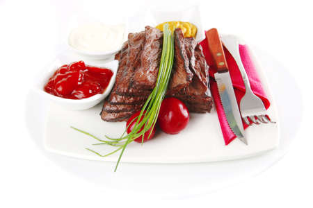 served sectioned beef meat on white dish