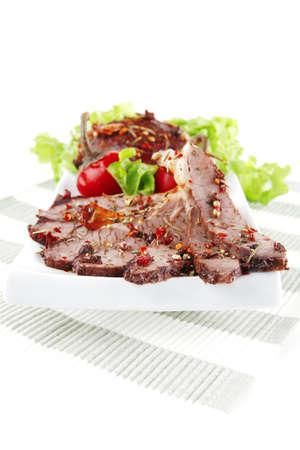 fresh roast beef meat slices on tissue photo