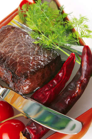 roast beef meat with tomatoes and peppers photo