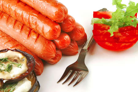 grilled beef sausages served on white background photo