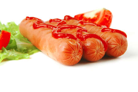 row of three sausages served with ketchup photo