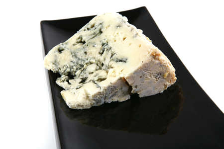 veined: french gorgonzola soft cheese on black plate Stock Photo