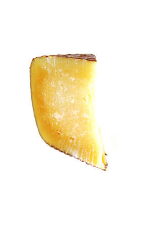 veined: piece of parmesan cheese over white background