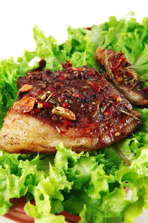 single served steak on raw green salad photo