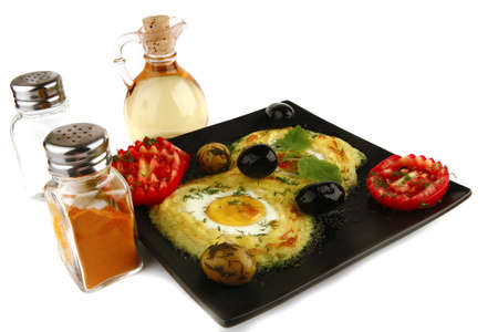 mash served with eye eggs and spices photo