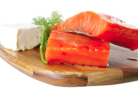 sinlge pink salmon bit on a big wooden dish with white cheese Stock Photo - 6922518