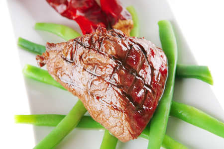 served roast veal fillet on a white plate photo