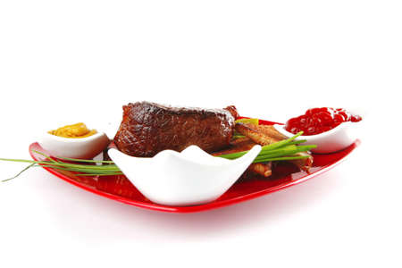 beef chunk on red dish with seasoning photo