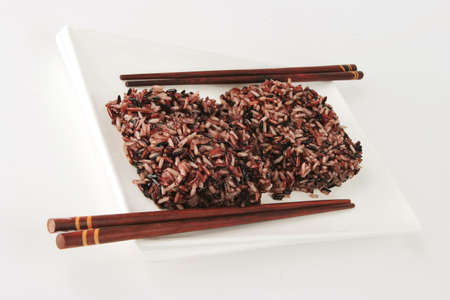 boiled dark mixed rice on white plate photo
