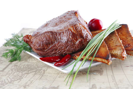 grilled meat on dish with bread and vegetables photo