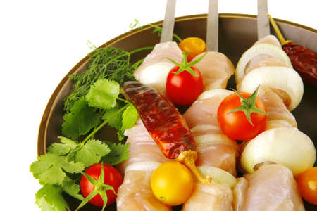 raw chicken kebabs served on skewers with vegetables Stock Photo - 6986704