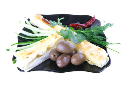 baked cannelloni served with pepper and olives photo