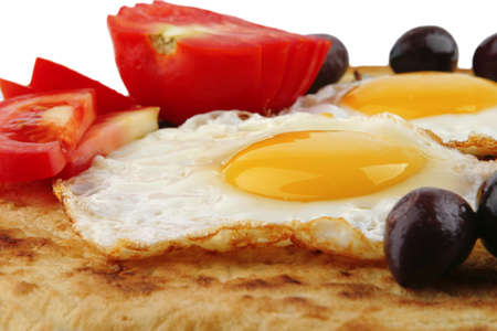 fried eggs on pancake over white background Stock Photo - 7074805