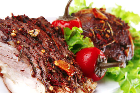 beef steak and slice on green salad over white photo