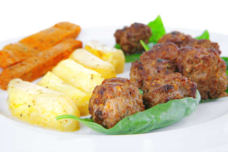 fried french cutlets with potatoes and basil photo