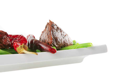 juice roast fillet mignon served on a white plate with peppers photo
