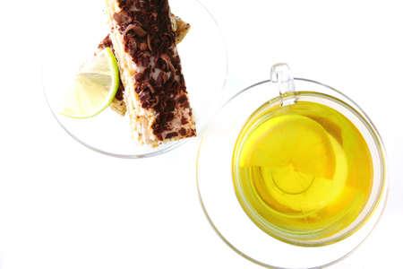 black tea and lemon cake on white background photo