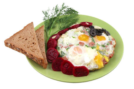fried egg served with bread and vegetables over white photo