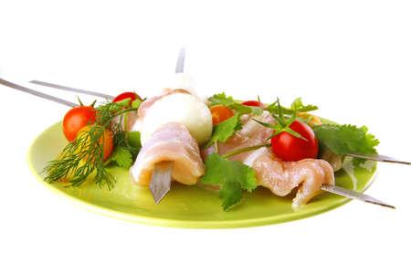 served fresh chicken kebabs on dark plate photo