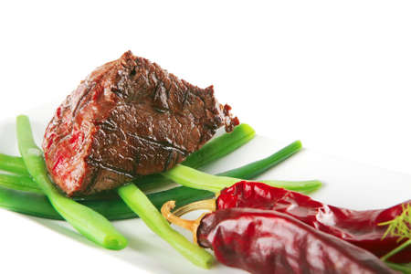 served roast fillet mignon on a white ceramic plate Stock Photo