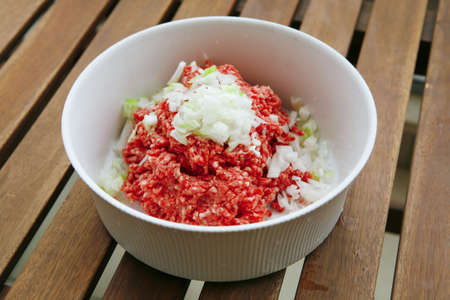 image of minced meat in big white bowl photo