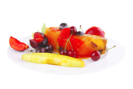 fruit ice cream with fruits on big white plate photo