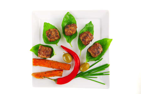 beef small cutlets with basil and hot chilli pepper photo