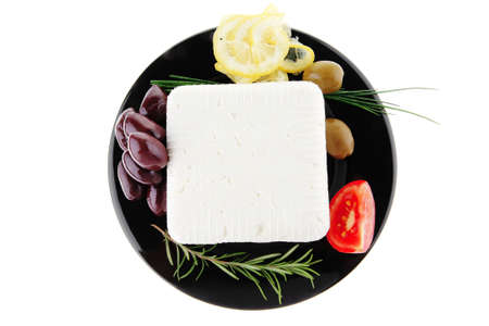 image of feta cube on black plate Stock Photo - 7277171