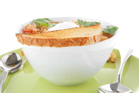 image of vegetable soup in big white bowl photo