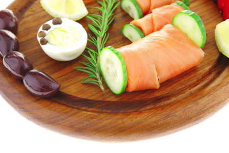 image of smoked salmon slices on dark wood photo