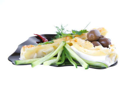 cheese cannelloni served with vegetables on black plate photo