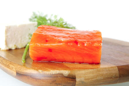 smoked fresh salmon piece with olives and white cheese photo
