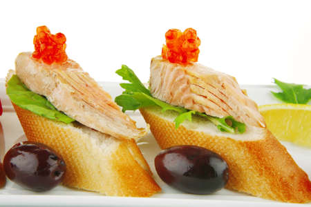 fried salmon on baguettes isolated over white photo