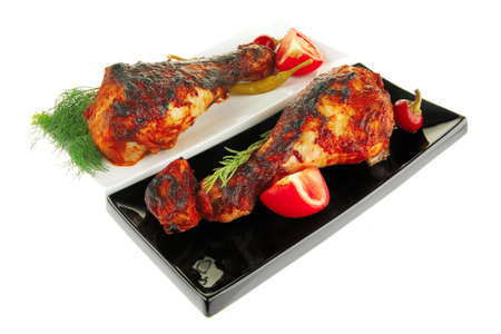 fresh grilled drumstick on plates with vegetables photo