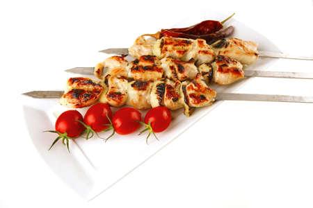 fresh roast shish kebab on white platter