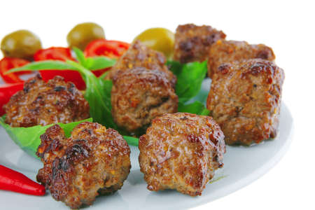 beef meat cutlets served on basil leaf photo