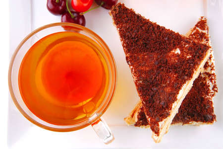 black english tea and cakes with red cherry photo