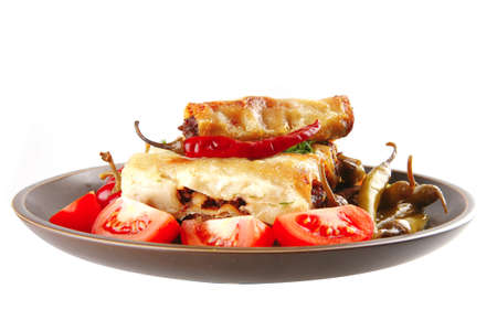 traditional italian cannelloni with mince meat and tomato photo