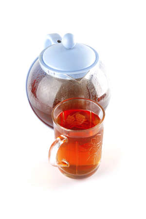 black tea in glass and kettle on white photo
