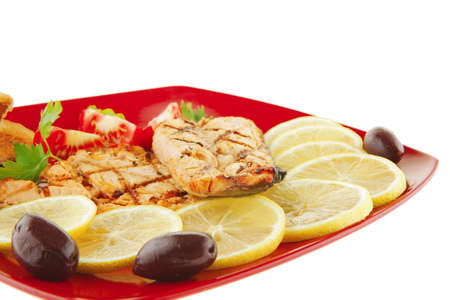 roast red salmon with lemon and tomatoes photo
