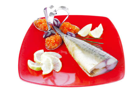 fish on red plate with lemon and caviar photo