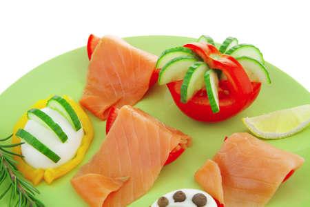 image of smoked salmon slices on green photo