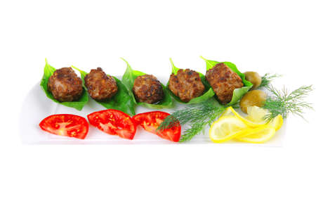 french beef meat cutlets and vegetables on white photo