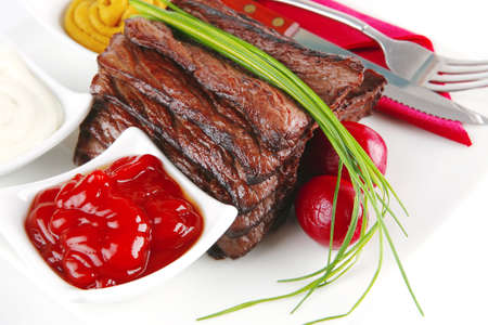 served meat and dishware on white dish photo